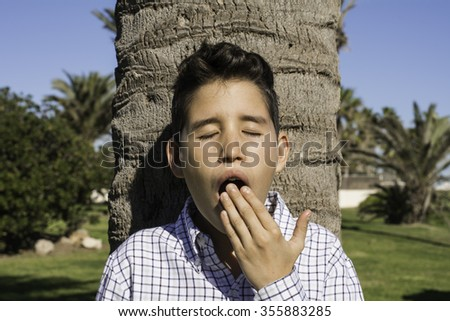 yawning boy - stock photo