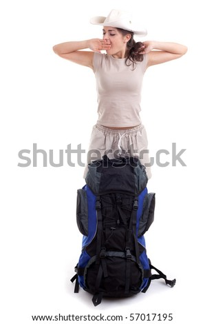 yawning stretching tourist woman with blue backpack