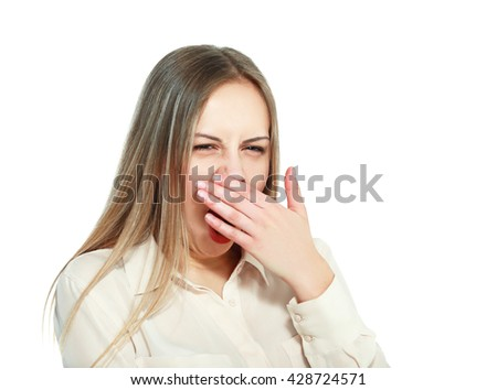 Yawning tired woman. Beautiful caucasian model isolated on white background. - stock photo