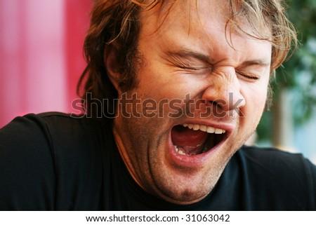 yawning young man - stock photo
