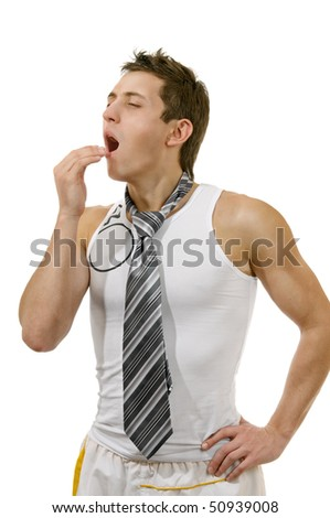 Yawning young man isolated on white - stock photo