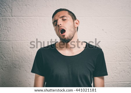 Yawns. Man - stock photo