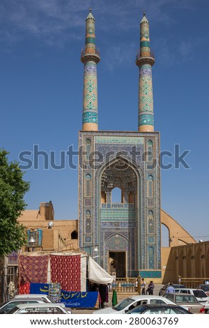 YAZD, IRAN - APRIL 27, 2015: Jame Mosque of Yazd, in Iran. The mosque is crowned by a pair of minarets, the highest in Iran.