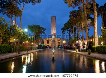 YAZD, IRAN - March 27: Illuminated Bagh-e Dolatabad on March 27, 2012 in Yazd, Iran. This garden is a famous landmark and its pavilion is renowned for having world's tallest badgir (Windcatcher). - stock photo