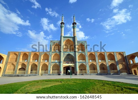 YAZD, IRAN - OCTOBER 11: Amir Chakhmaq Complex on October 11, 2013 in Yazd, Iran. Amir Chakhmaq Complex consists of a mosque, a bazaar and so on.Current structure was built in the nineteenth century. - stock photo
