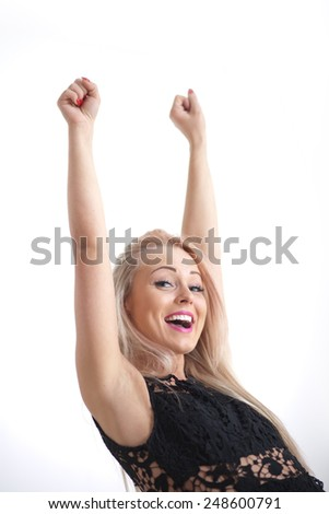 yeah says a blonde smiling beautiful woman while exulting with both her rising arms - stock photo