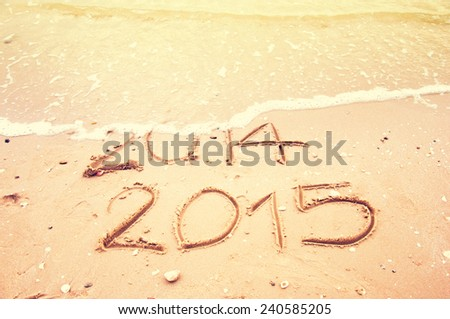 Year 2015 Coming writing on the beach Vintage tone - stock photo