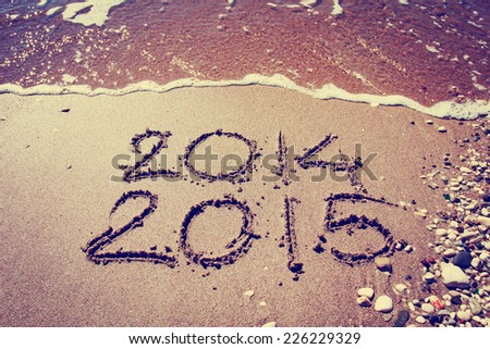 Year 2015 number written on sandy beach/New year 2015 background - stock photo