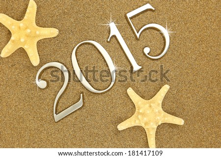 Year 2015 numbers on the sand - stock photo