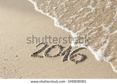 Year 2016 on sand - stock photo