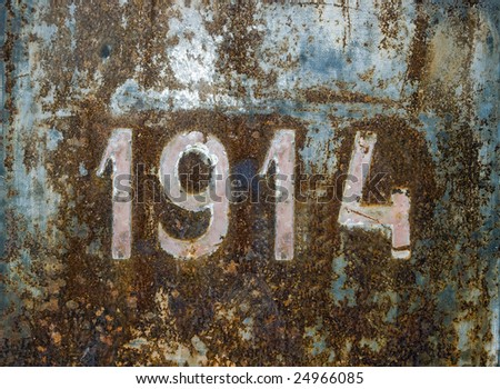 Year 1914 over a rusty steel plate.Beginning of first World War. - stock photo