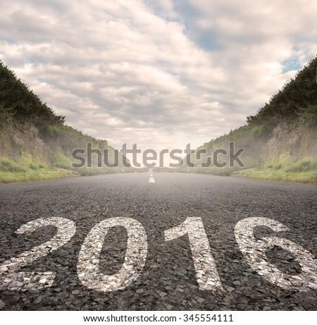 year 2016 painted on asphalt road - stock photo