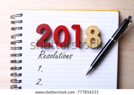 Year 2018 resolutions on notepad