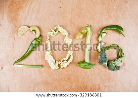 Year 2016 shape made of healthy food green vegetables, concept - stock photo