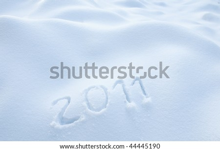 Year 2011 written in Snow - stock photo