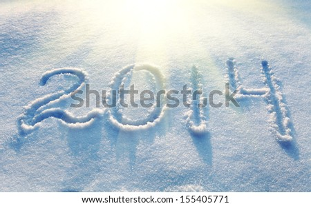 Year 2014 written in Snow in High Key  - stock photo