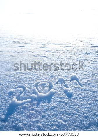 Year 2011 written in Snow in High Key - stock photo
