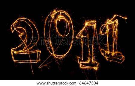 Year 2011 written in sparklers on black. Use for celebrations like New Years, 4th July, Bastille Day. - stock photo