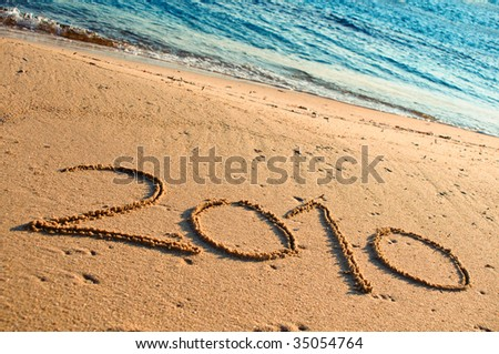 Year 2010 Written in the Sand - stock photo