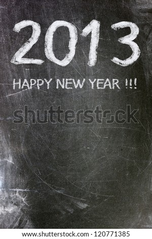 Year 2013 written in white chalk on a blackboard. - stock photo