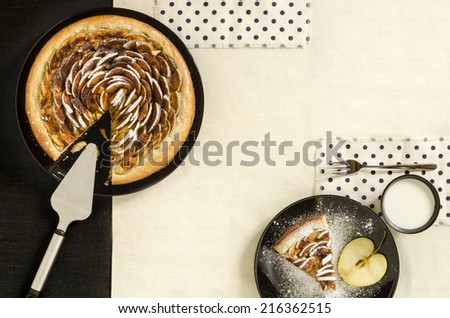 Yeast pie with cinnamon and sugar on black plate. From a series Apple time - stock photo
