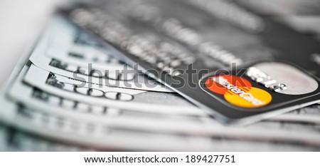 YEKATERINBURG, RUSSIA - APR 25, 2014: Mastercard Debit Card Over Dollar bills  - stock photo