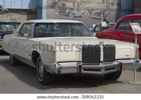 YEKATERINBURG, RUSSIA - AUGUST 16, 2015: American retro car Chrysler New Yorker 1976 presented at the exhibition in retro Russian city of Yekaterinburg.