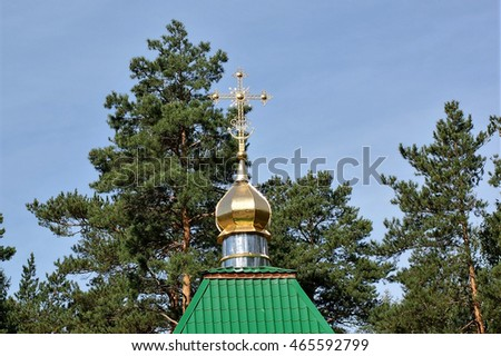 "Yekaterinburg, Russia. August 27, 2011 Church of the Icon of the Mother of God ""Life-giving Spring"" at the monastery in Ganina Yama urchische. Domes and crosses"