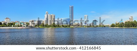 YEKATERINBURG, RUSSIA - JULY 21, 2015: Panorama of Yekaterinburg-City from the city pond. It is a commercial center with area of five hectares which combines more than 400,000 sq.m of commercial space