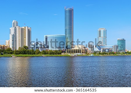 YEKATERINBURG, RUSSIA - JULY 21, 2015: View of Yekaterinburg-City from the city pond. It is a commercial center with area of five hectares which combines more than 400,000 sq.m of commercial space. - stock photo