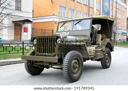 YEKATERINBURG, RUSSIA - MAY 9, 2014: American command car Willys MB exhibited at the annual Victory day Parade. - stock photo
