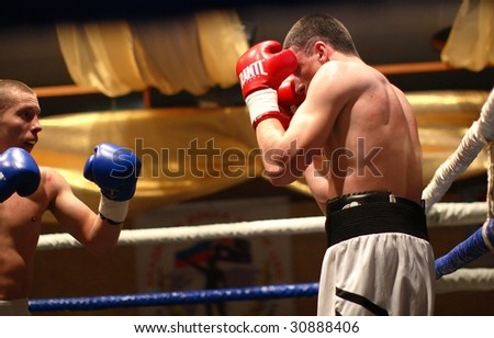 YEKATERINBURG, RUSSIA - MAY 21: Boxers Alexandr Ivahnov and Alexandr Subbotov in action during an international professional boxing tournament on  May 21, 2009 in Yekaterinburg.