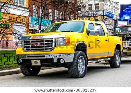 YEKATERINBURG, RUSSIA - MAY 9, 2014: Motor car GMC Sierra 2500HD at the city street. - stock photo