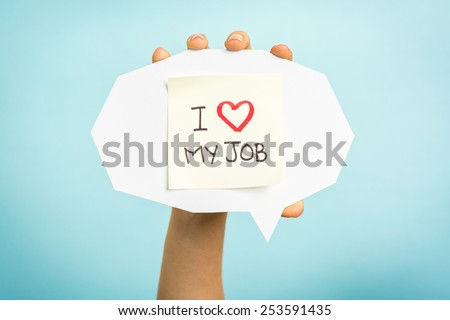 "Yellow adhesive note on speech bubble with ""I love my job"" words"