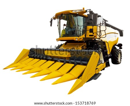 Yellow agricultural harvester - stock photo