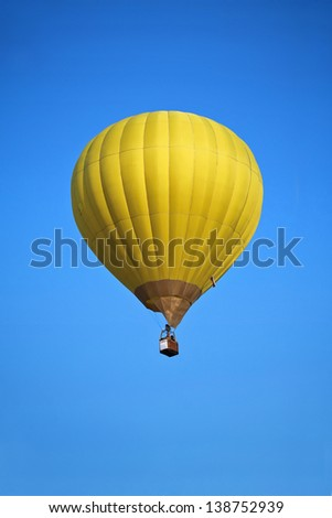 Yellow air balloon in the clear blue sky