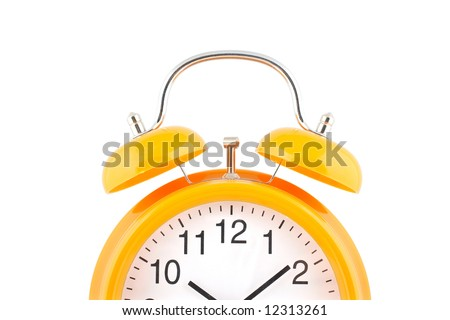 Yellow alarm clock with bells on top isolated over white background - stock photo