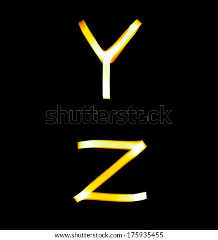 yellow alphabet created with light (Y, Z) - stock photo
