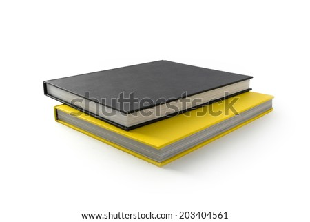 Yellow and black books. Closed books is laying on white.  - stock photo