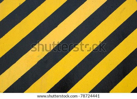 Yellow and black lines painted on a boat - stock photo