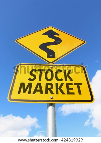 yellow and black Stock Market road sign in a blue sky - stock photo