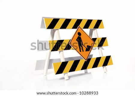 Yellow and black striped road construction barrier with Worker roadsign over white background - stock photo