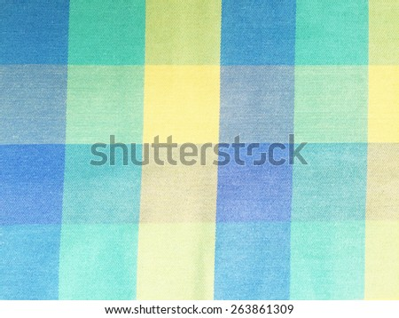 Yellow and blue checkered tablecloth, checked fabric - stock photo