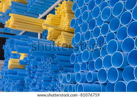 yellow and blue pvc pipes - stock photo