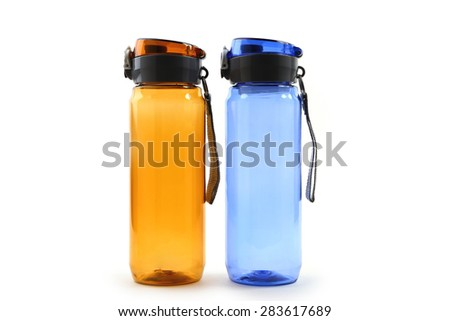 yellow and blue sport bottle on white background - stock photo