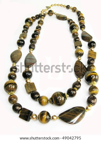 yellow and brown tiger's eye mineral beads isolated on white background - stock photo