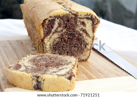 Yellow and chocolate cake fresh from the oven. - stock photo