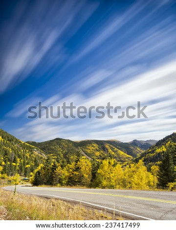 Yellow and golden aspens framing the High Road to Taos, NM - stock photo