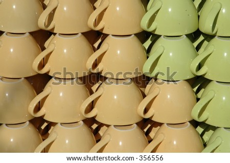 Yellow and green cups. - stock photo
