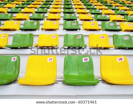 Yellow and Green Seat Pattern in Football Stadium - stock photo